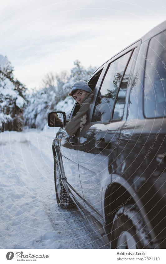 Man in car on winter road Car Street Winter Forest off roadster Human being Driver Snow Cold Asphalt Landscape White Nature Seasons Ice Frost Vacation & Travel