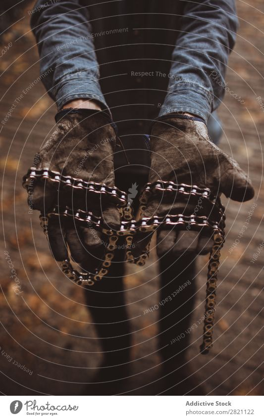 Man holding motorcycle chains Gloves Hand Workwear Iron chain Motorcycle Dirty Equipment Protective Protection Safety Employees & Colleagues Industry