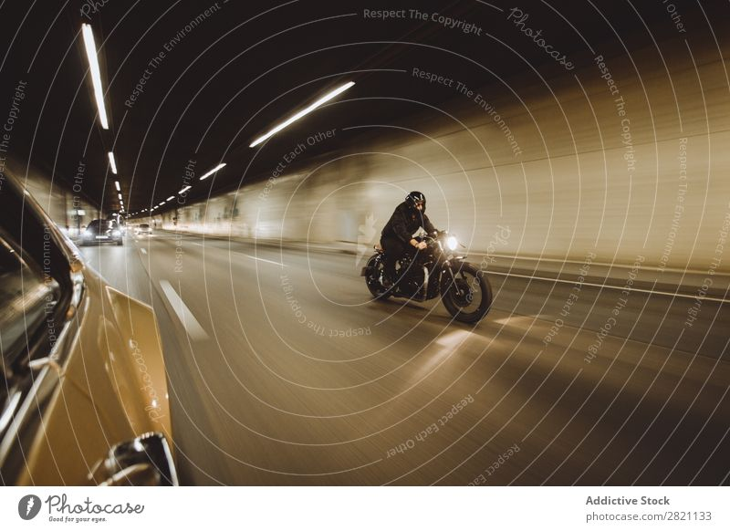 Biker riding in tunnel Man Motorcycling Motorcycle Speed Ride Tunnel Engines Bicycle Rider Vacation & Travel Lifestyle Street Racing sports Freedom Adventure