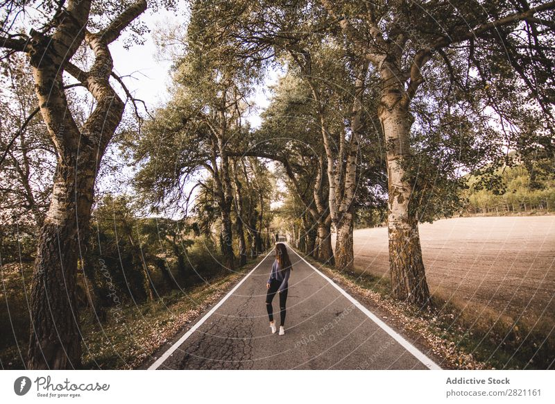 Woman walking on rural road Street Field Vacation & Travel Landscape fresh air Gravel Retro Grass Dry Nature way Lanes & trails Highway Beautiful Picturesque