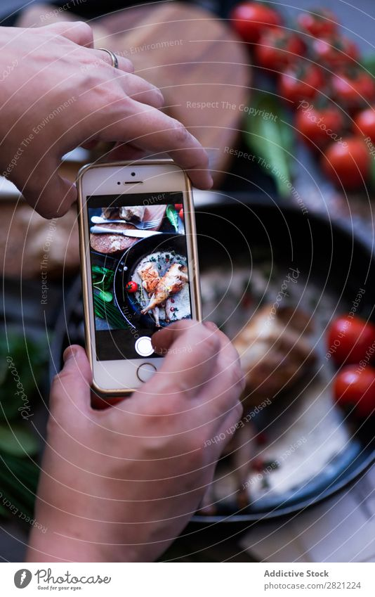 Hands taking shot of appetizing dish Poultry Tasty Dish Pan Frying Shot Take Display PDA Screen Tomato served Dinner Roasted Meal Meat Cooking Gourmet Food