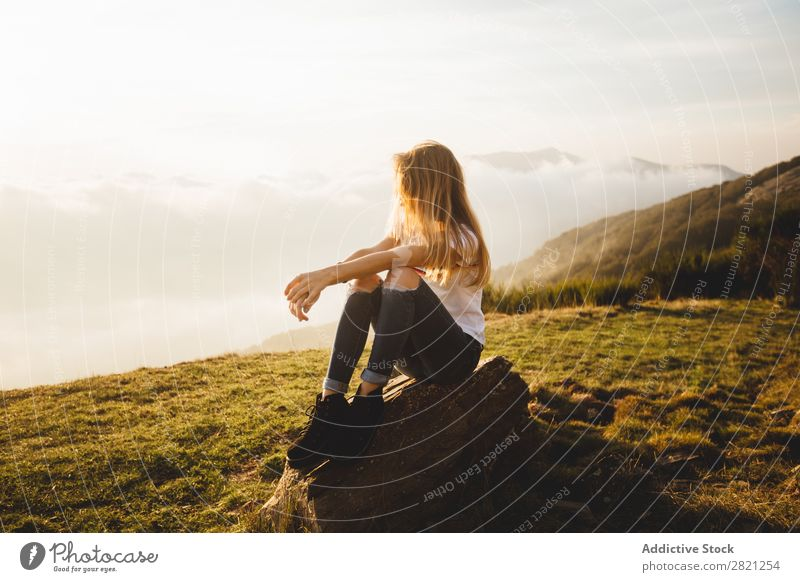 Young woman posing on a hill Woman Nature enjoying Freedom Lifestyle Human being Leisure and hobbies Sunlight Sunbeam Day Beautiful Lovely Charming Cute Grass