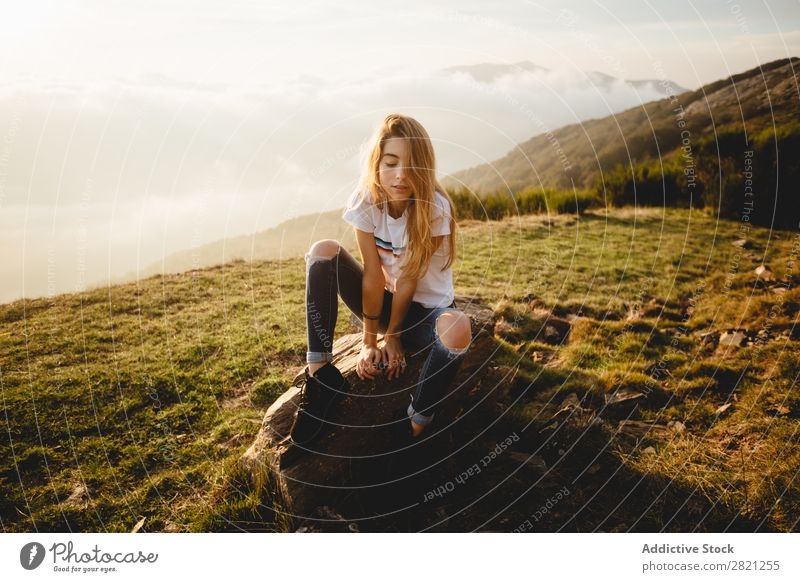 Young woman sitting on stone Woman Nature Stone Freedom Lifestyle Human being Leisure and hobbies Sunlight Sunbeam Day Beautiful Lovely Charming Cute Grass