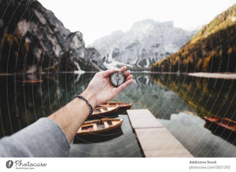 Hand with compass Human being Compass (drafting) Mountain Lake Nature Vacation & Travel Adventure Tourism