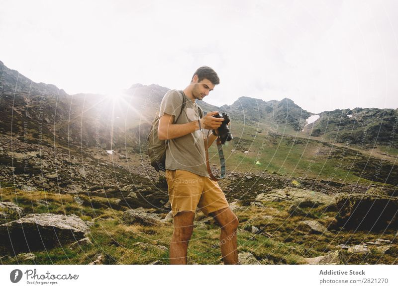 Man browsing camera in mountains Photographer Mountain Camera Nature Landscape Photography Hiking Tourist Vacation & Travel Professional Tourism Adventure