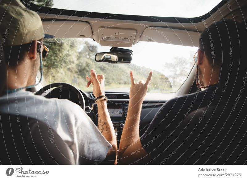 Men gesturing in a car Driving Car Man Friendship Gesture Welcome Trip Happy
