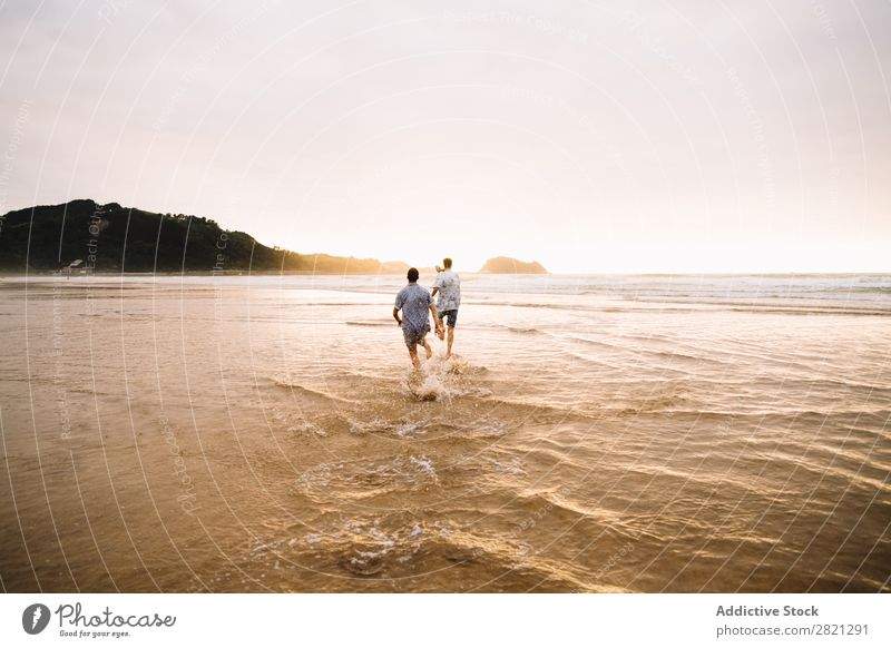 Men walking to ocean Man Walking Beach Ocean Together Friendship Couple Homosexual Water Sand Vacation & Travel Youth (Young adults) Alternative Nature