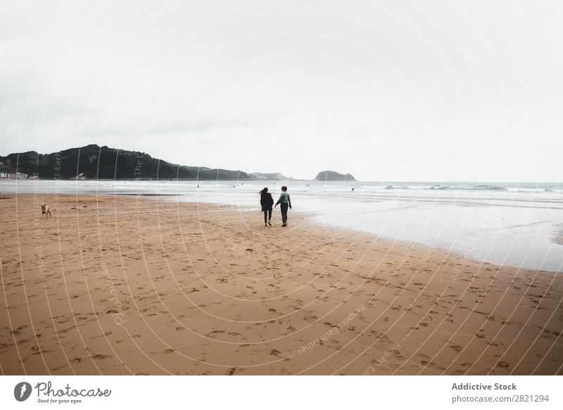 Men walking to ocean Man Walking Beach Ocean Together Friendship Couple