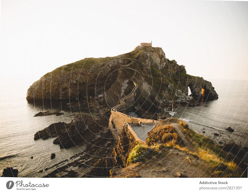 Cliff in ocean with walkway Landscape Corridor Ocean Rock Traveling Nature Dramatic tranquil Green Coast Panorama (Format) Attraction Environment seascape