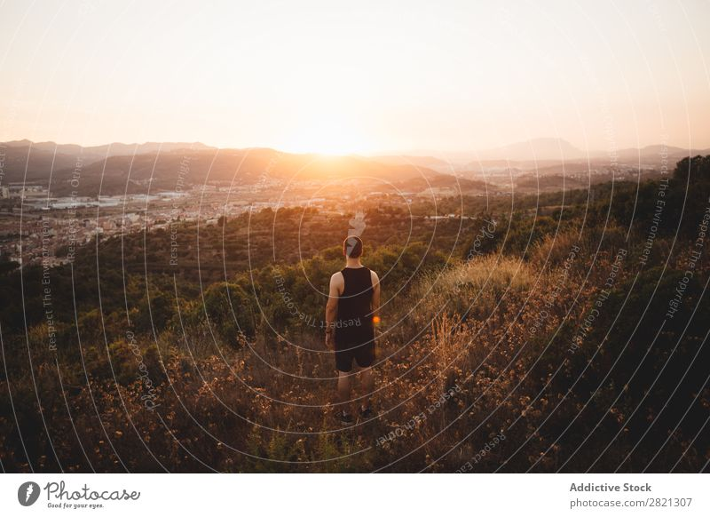 Anonymous man posing in plain Man Landscape Field Sunset Nature Summer Meadow Action Rural Environment Adventure Leisure and hobbies Evening Natural Sunrise Sky