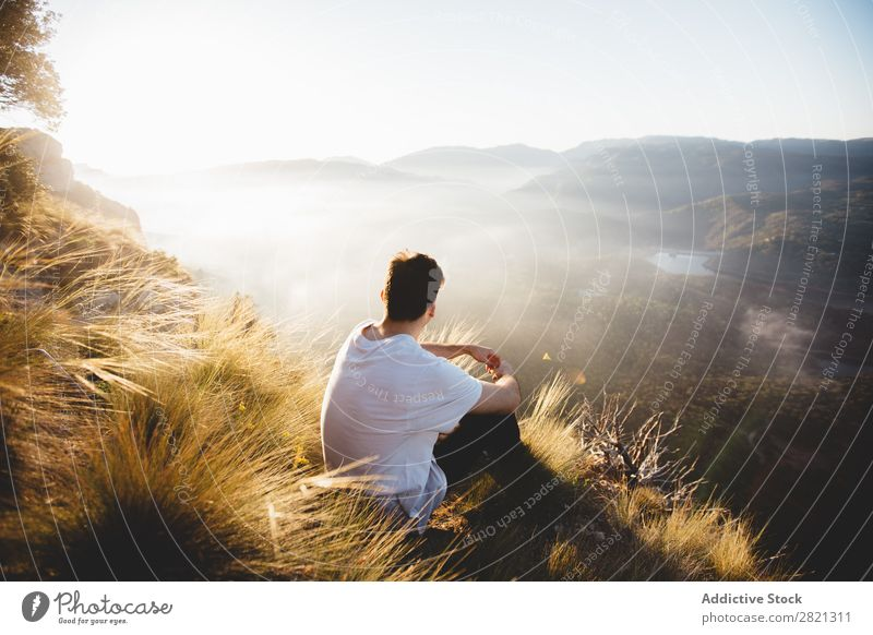 Man sitting on top of hill Mountain Landscape Vantage point PDA Network Weather Walking Relaxation Technology Tourism scenery traveler Panorama (Format)