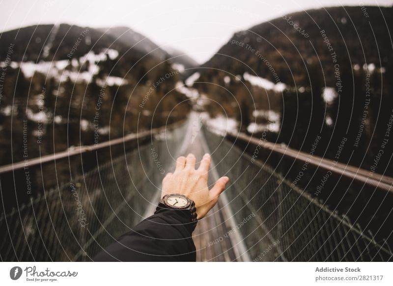 Crop hand outstretched towards landscape Man traveler Mountain Hand Outstretched Bridge Tourism Freedom Indicate body part Crops pathway Style Wanderlust