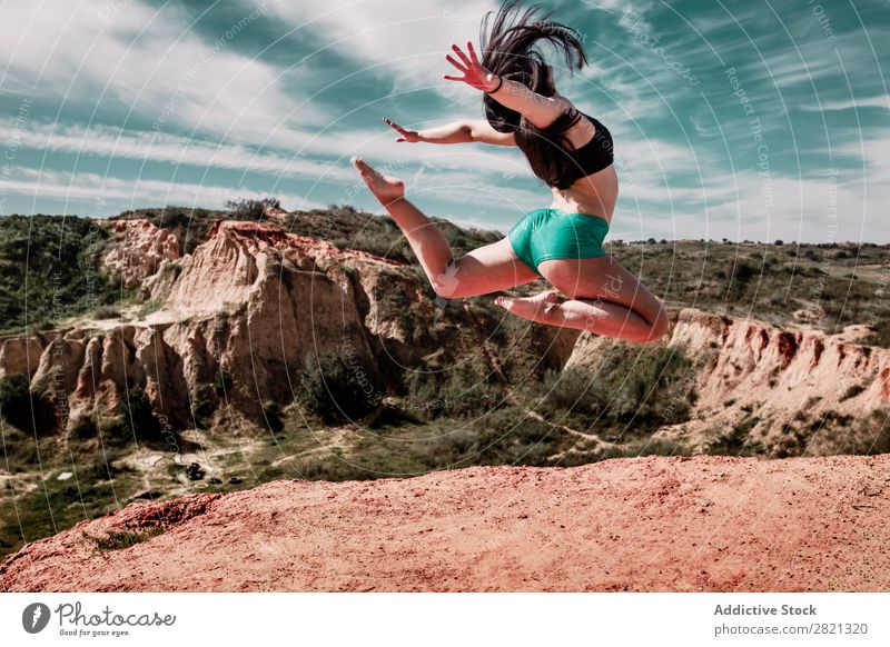 Sporty woman stretching on hill Woman Athletic Hill workout Stretching Legs Nature Lifestyle Mountain Human being Sports Sky Landscape Adventure Beautiful
