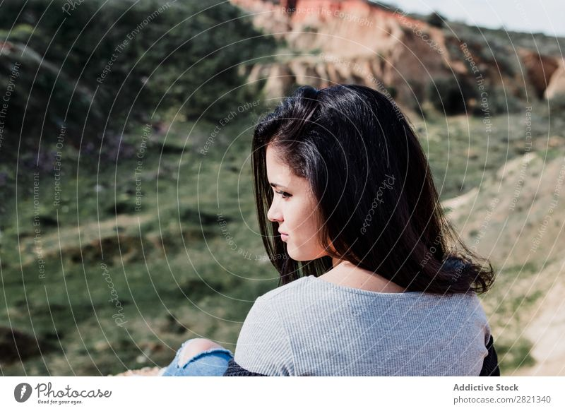 Young brunette woman sitting on hill Woman pretty Youth (Young adults) Beautiful Sit Edge Hill Cliff Brunette Attractive Human being Beauty Photography Adults