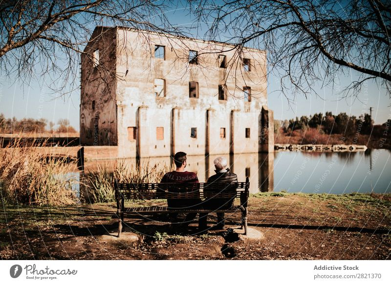People on bench looking at ruins Human being Bench Park Building Ruin Lake Sit Observe Architecture Landscape Sky Nature Old Water Tourism Landmark