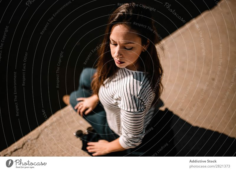 Pretty woman sitting at water Woman pretty Youth (Young adults) Sit Beautiful Sunglasses Water Embankment Sunbeam eyes closed To enjoy Brunette Attractive