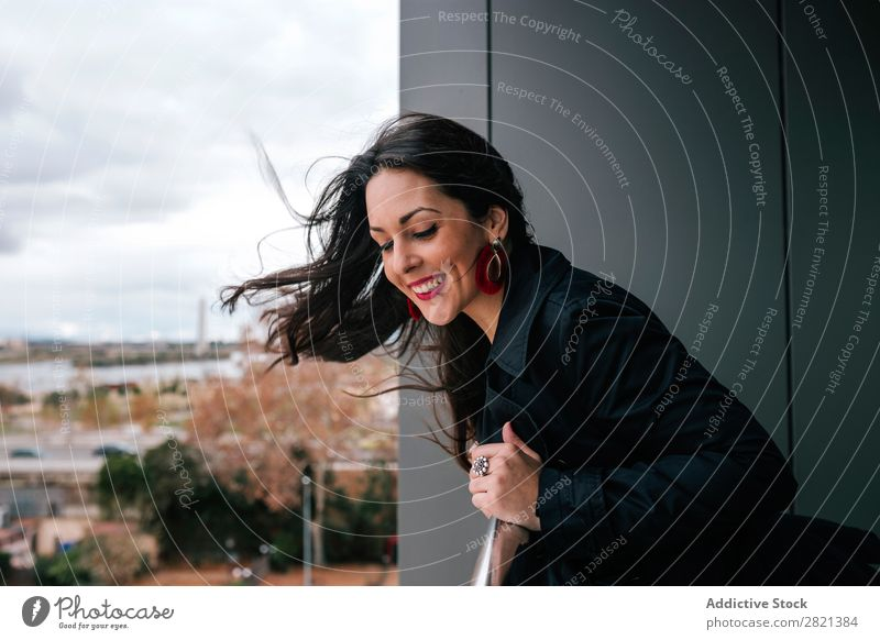 Cheerful woman standing at handrail Woman pretty Youth (Young adults) Beautiful Smiling Stand Balcony Building Modern Contemporary Brunette Attractive