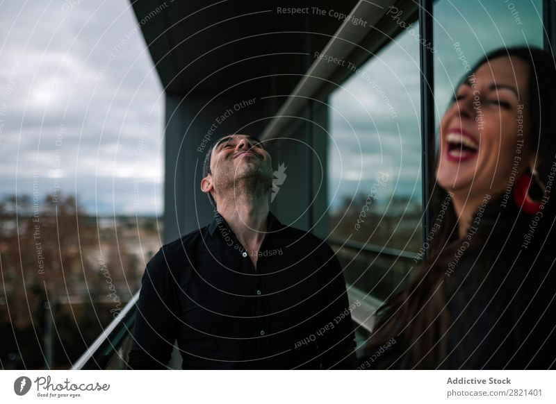Adult couple standing on balcony Couple Adults Stand Balcony Woman Man Together Love Cheerful Flirt Lifestyle Romance Human being Beautiful romantic 2 Happy