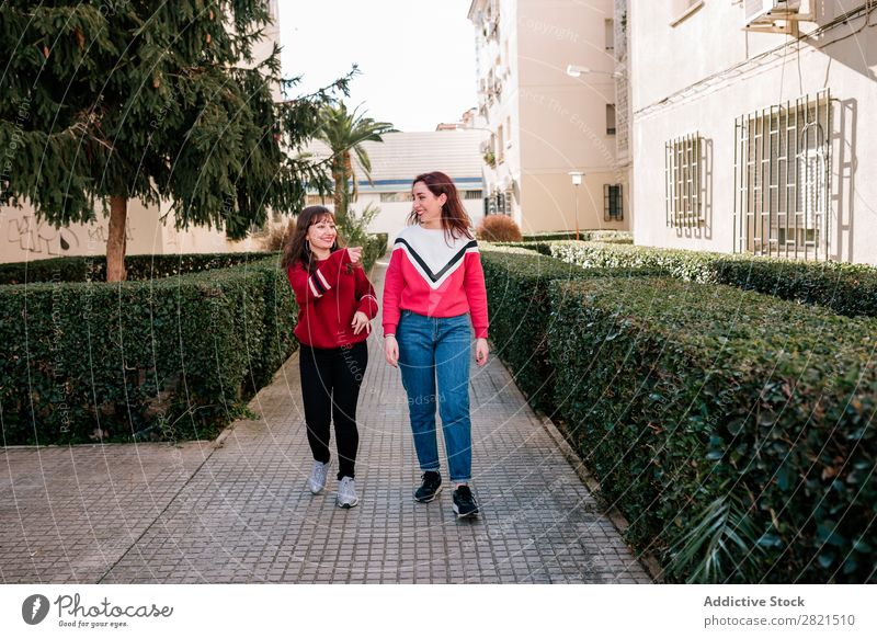 friends walking down the street Girl Woman Youth (Young adults) Friendship Happiness confidences Self-confident Attachment Caucasian Smiling Laughter Joy