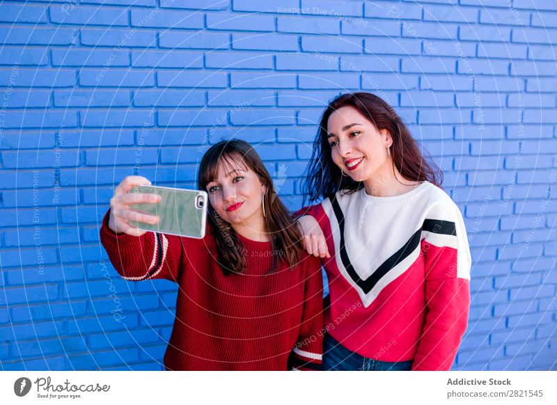 friends taking a picture Girl Woman Youth (Young adults) Friendship Happiness confidences Self-confident Attachment Caucasian Smiling Laughter Embrace Joy