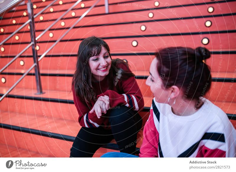 girlfriends sitting on stairs talking Girl Woman Youth (Young adults) Friendship Happiness confidences Self-confident Attachment Caucasian Smiling Laughter