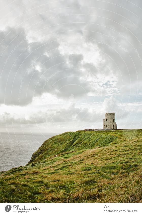 country's end Nature Landscape Water Sky Clouds Grass Waves Coast Ocean Cliff Ireland Tower Manmade structures Cliffs of Moher Gray Green Colour photo