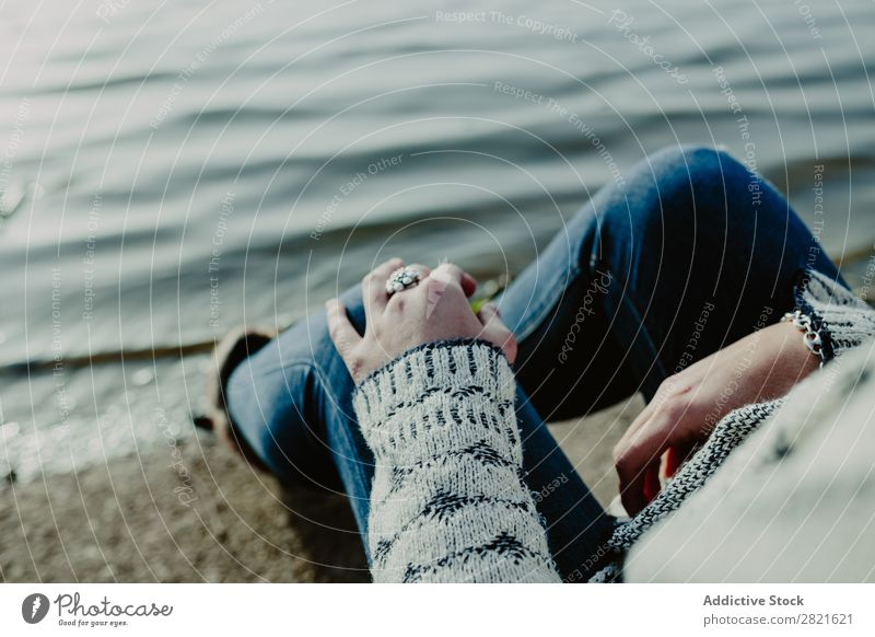 Crop woman on beach Woman Coast Nature Cold Clothing Loneliness Holiday season Autumn Easygoing Rural romantic Beach Peaceful Sit Relaxation Dream Sand