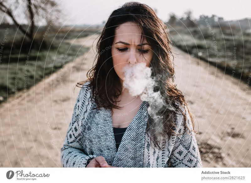 Girl smoking on rural road Woman Rural Smoke Nature electronic cigarette Landscape Youth (Young adults) Peaceful Cigarette Clothing Relaxation Street