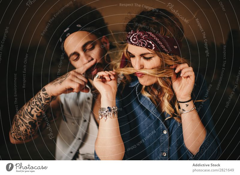 Couple making moustache with hair and finger Joy Hair Wind having fun Portrait photograph Fingers Hair and hairstyles Tattoo Smiling pretty Beautiful Attractive