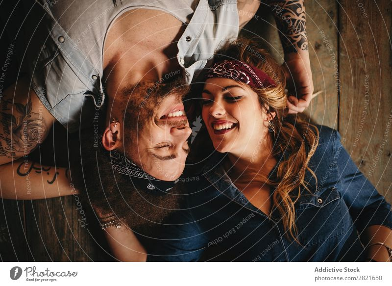 Happy couple on wooden background Couple Portrait photograph Above Wood Background picture Lie (Untruth) Bird's-eye view Smiling Happiness Cheerful Headband