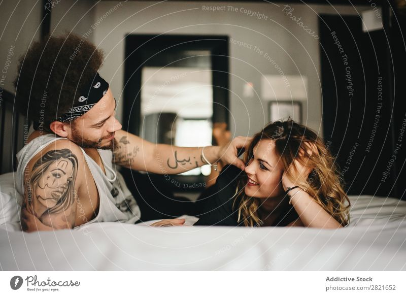 smiling couple on bed Couple Bed Bedroom Smiling Touch tender Hair and hairstyles Lie (Untruth) Relaxation Home Interior shot Together Interior design Looking