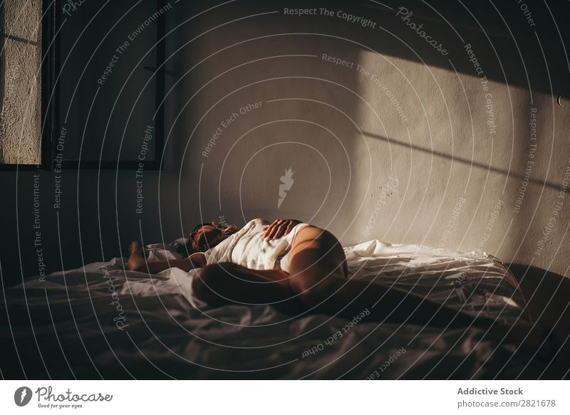 Sensual woman lying on bed in sunlight Woman Bed Lie (Untruth) Sleep Sunlight Copy Space Background picture Intimate Intimacy Wall (building) Skin tan