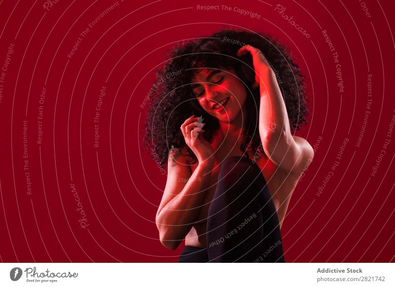 Topless curly woman with headphones in studio Woman Portrait photograph Youth (Young adults) Headphones Music Listening Joy Beautiful