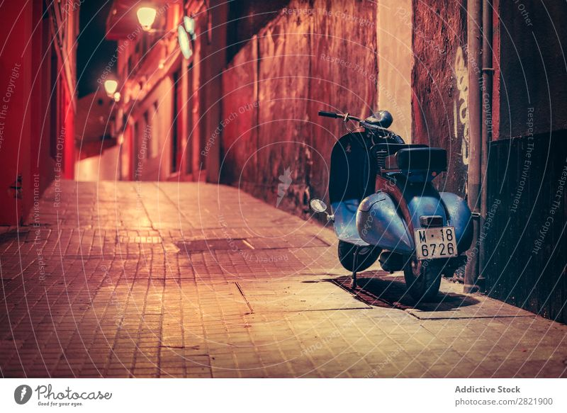 Scooter parked on night street Street Night Dark Parked Blue Town Light City Building Architecture Alley Asphalt Vacation & Travel Evening way Twilight Deserted