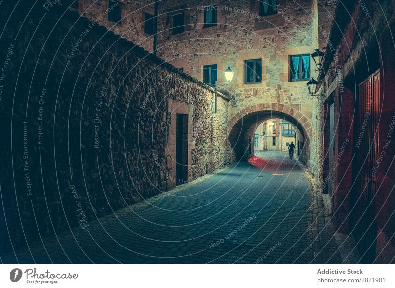 Person walking on street at night Street Night Dark Town Light City Human being Walking Building Architecture Alley Asphalt Vacation & Travel Evening way