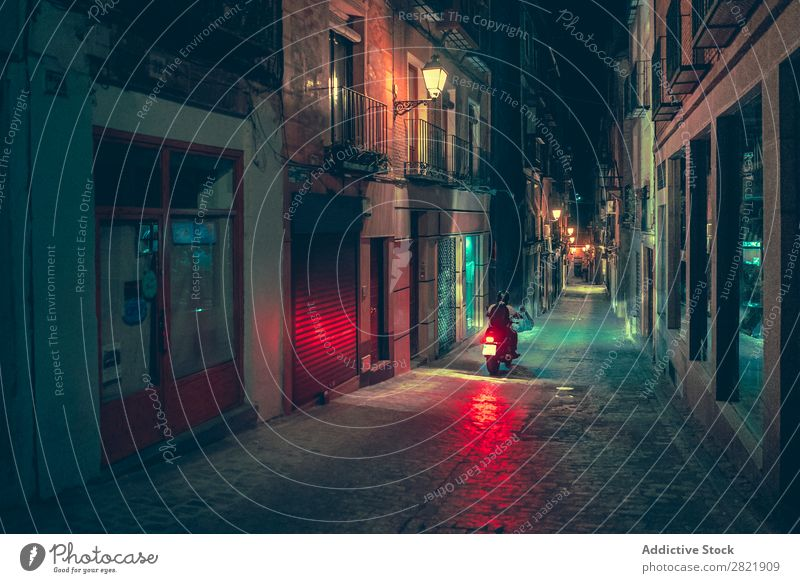 Biker riding on street at night Street Night Dark Town Light Human being Motorcycle Bicycle Rider City Building Architecture Alley Asphalt Vacation & Travel