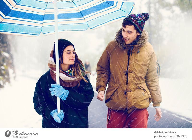 Couple walking on road in woods Friendship Forest Entertainment Leisure and hobbies Action Winter Snow Nature Exterior shot Vacation & Travel Group Weather