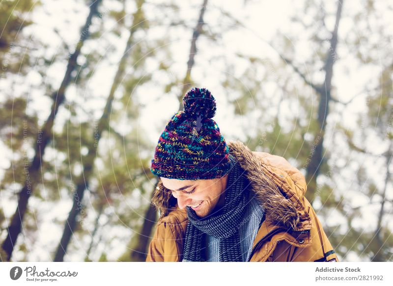 Man playing snowballs in woods Snow ball Playing Forest having fun Entertainment Leisure and hobbies Action Movement Winter Nature Exterior shot