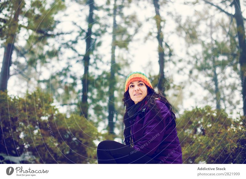 Woman posing in woods Snow ball Playing Forest throwing having fun Entertainment Leisure and hobbies Action Movement Winter Nature Exterior shot