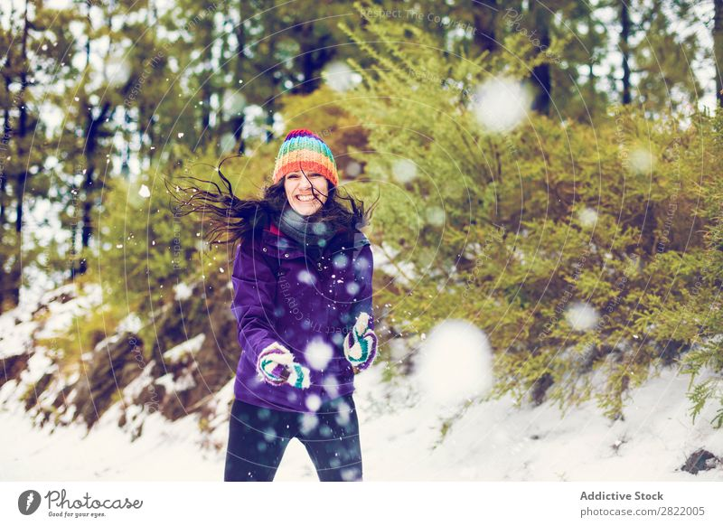 Woman playing snowballs in woods Human being Friendship Snow ball Playing Forest throwing having fun Entertainment Leisure and hobbies Action Movement Winter