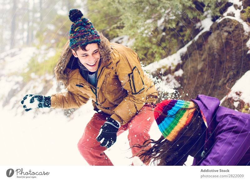 Friends playing snowballs in woods Human being Friendship Snow ball Playing Forest throwing having fun Entertainment Leisure and hobbies Action Movement Winter
