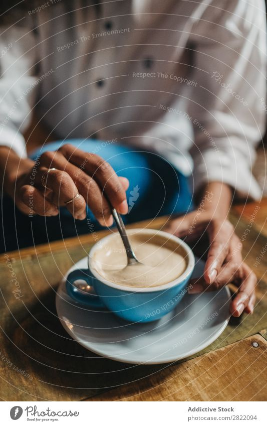 Crop woman stirring cup of coffee Woman Beautiful Ethnic Black Crops Youth (Young adults) African Stir Coffee Cup latte Brunette Attractive Human being
