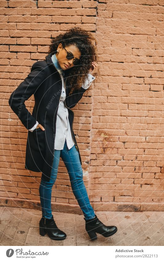 Stylish woman at brick wall Woman Beautiful Ethnic Black Curly African Youth (Young adults) Stand