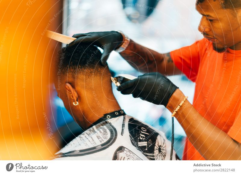 Barber using grooming machine Barber shop Customer hair dress Hair salon Hairdresser Black Man Youth (Young adults) Client Hair Stylist Hair and hairstyles