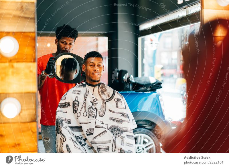 Barber showing haircut to customer Barber shop Customer hair dress Hair Indicate Mirror Reflection salon Hairdresser Black Man Youth (Young adults) Client