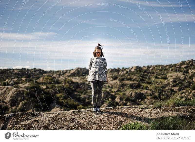 Pretty young woman standing on cliff Woman Style Nature Cliff Rock Stone Stand Sunbeam Day Attractive Beautiful Youth (Young adults) Fashion Hipster pretty