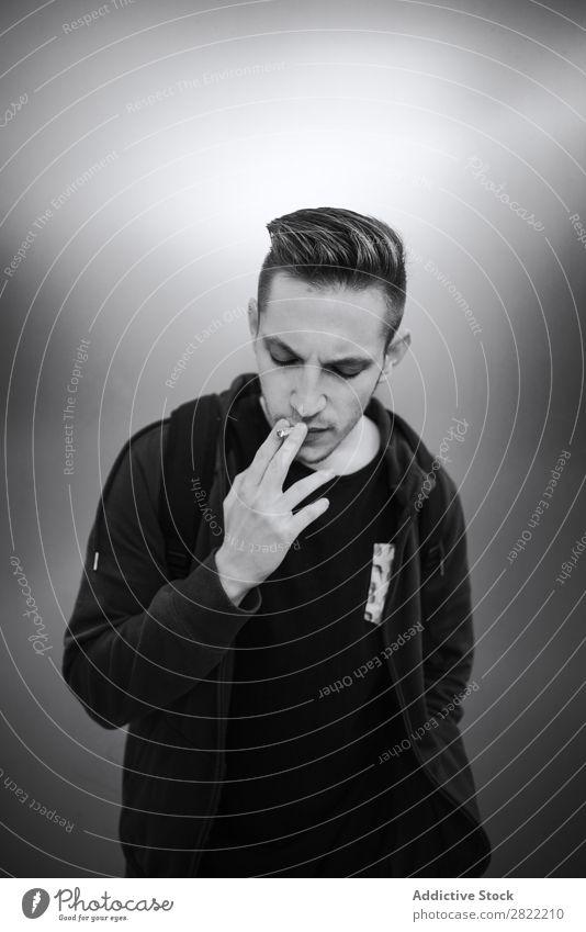 Young man smoking cigarette Man Smoke Style Inhale Addiction human face Smoke engine Expression Black & white photo inhaling Masculine Tobacco