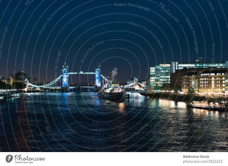 Glowing city embankment in night Skyline Embankment Tourism Bridge Town London Landmark England Light Architecture Vacation & Travel Night Structures and shapes