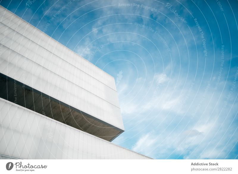 Modern concrete building in sunny day Corner Building Concrete Sky Architecture Exterior Design Construction Blue Town Deserted Structures and shapes