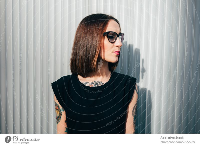 Stylish young woman standing at metal wall Woman Style Tattoo Street Beautiful Youth (Young adults) Sunglasses Fashion Hipster pretty Cool (slang)